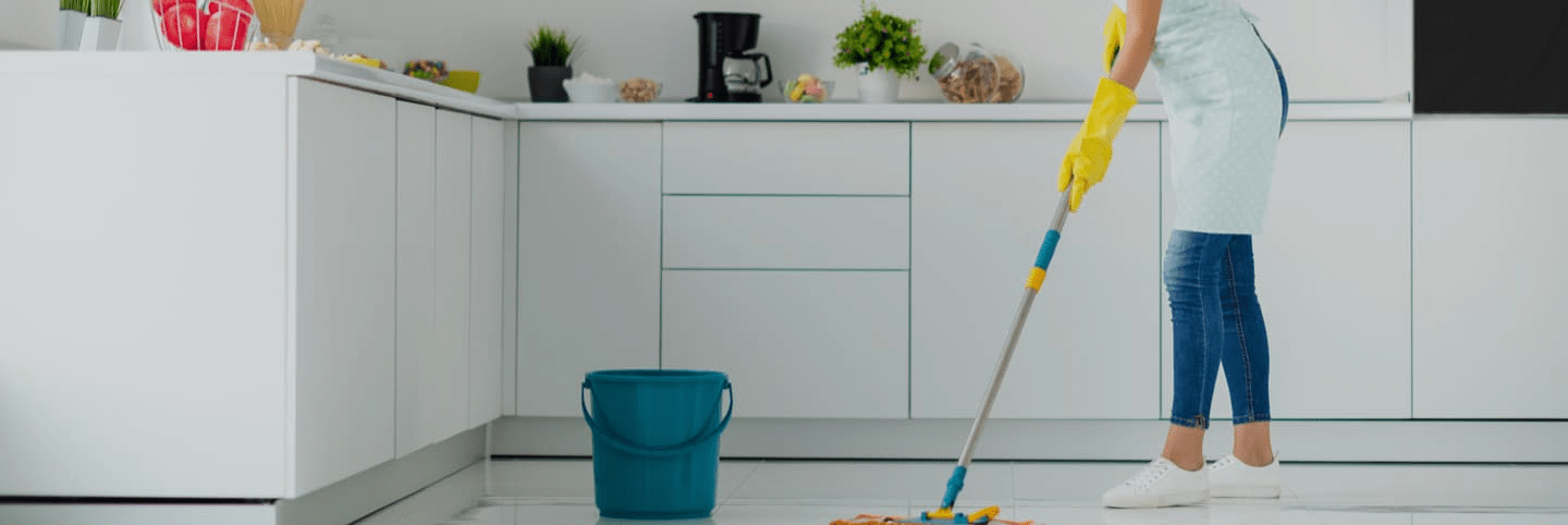 Woman mopping the floor in the Kitchen