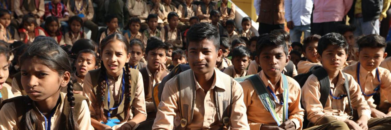 Pupils sitting on the ground